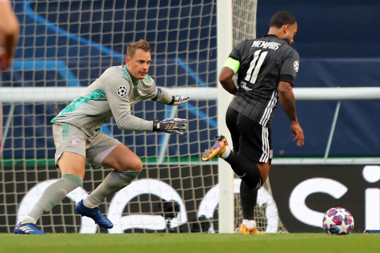 Bayern Munich goalkeeper Manuel Neuer faces Lyon forward Memphis Depay in the Germans' 3-0 win