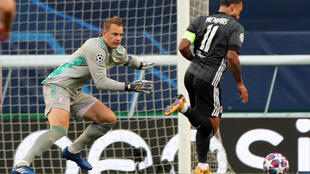 Bayern Munich goalkeeper Manuel Neuer faces Lyon forward Memphis Depay in the Germans' 3-0 win