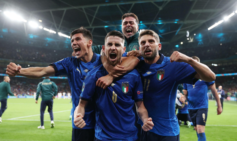 Spot on: Jorginho (centre) scored the winning penalty as Italy beat Spain to reach the Euro 2020 final