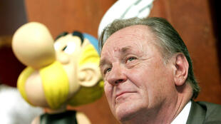 Albert Uderzo, the artist of all thirty-three Asterix adventures and story writer of the last nine books, sits next to a model of Asterix during a news conference in Brussels September 22, 2005