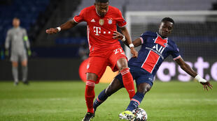 Funny old game: PSG's Idrissa Gueye tackles David Alaba of Bayern Munich in the second leg of theit Champions League quarter-final in Paris