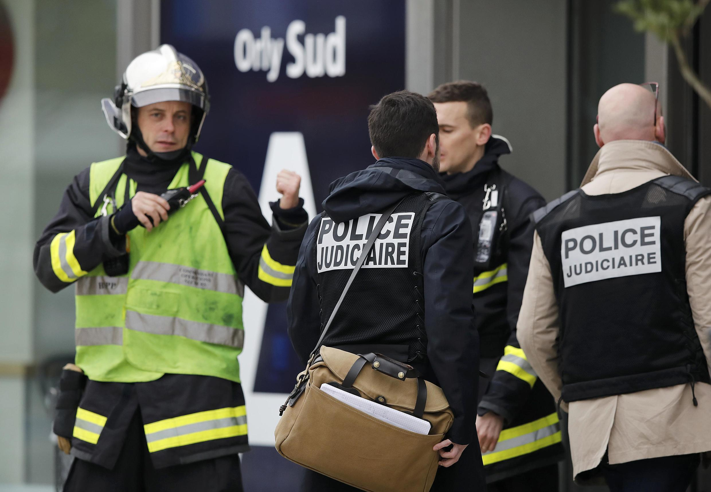 Judicial police investigators enter Orly airport southern terminal after a shooting incident near Paris, France March 18, 2017.