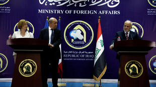 French Foreign Minister Jean-Yves Le Drian (C) and French Defence Minister Florence Parly (L) attend a joint news conference with Iraqi Foreign Minister Ibrahim al-Jaafari in Baghdad, Iraq August 26, 2017.