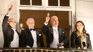 Nobel Peace Prize laureates of the Tunisian National Dialogue Quartet salute participants in a torch parade from the balcony of the Grand Hotel in Oslo, December 10, 2015