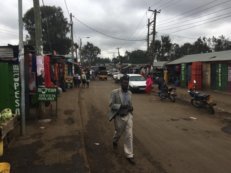Man works down the street in the Makina area of Kibera slum, 4 August 2017.