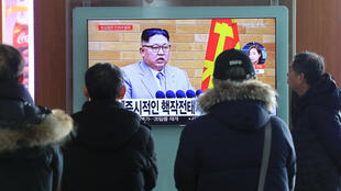 People watch images of North Korean leader Kim Jong-un's New Year's Day speech in Seoul, South Korea, 1 January 2018.