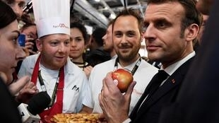 French President Emmanuel Macron has promised to protect farmers and fisherman at the 57th Paris International Agriculture Fair, 22 February 2020.