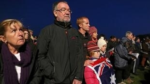 People attend a dawn service to mark the 98th Anzac commemoration ceremony at the Australian National Memorial in Villers-Bretonneux
