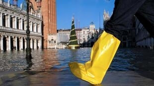 A person walks in St. Mark's Square during high tide in Venice, Italy December 24, 2019