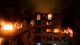 Residential building engulfed in flames, Paris