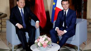 Main course: Xi and Macron before last night's working dinner near Nice.