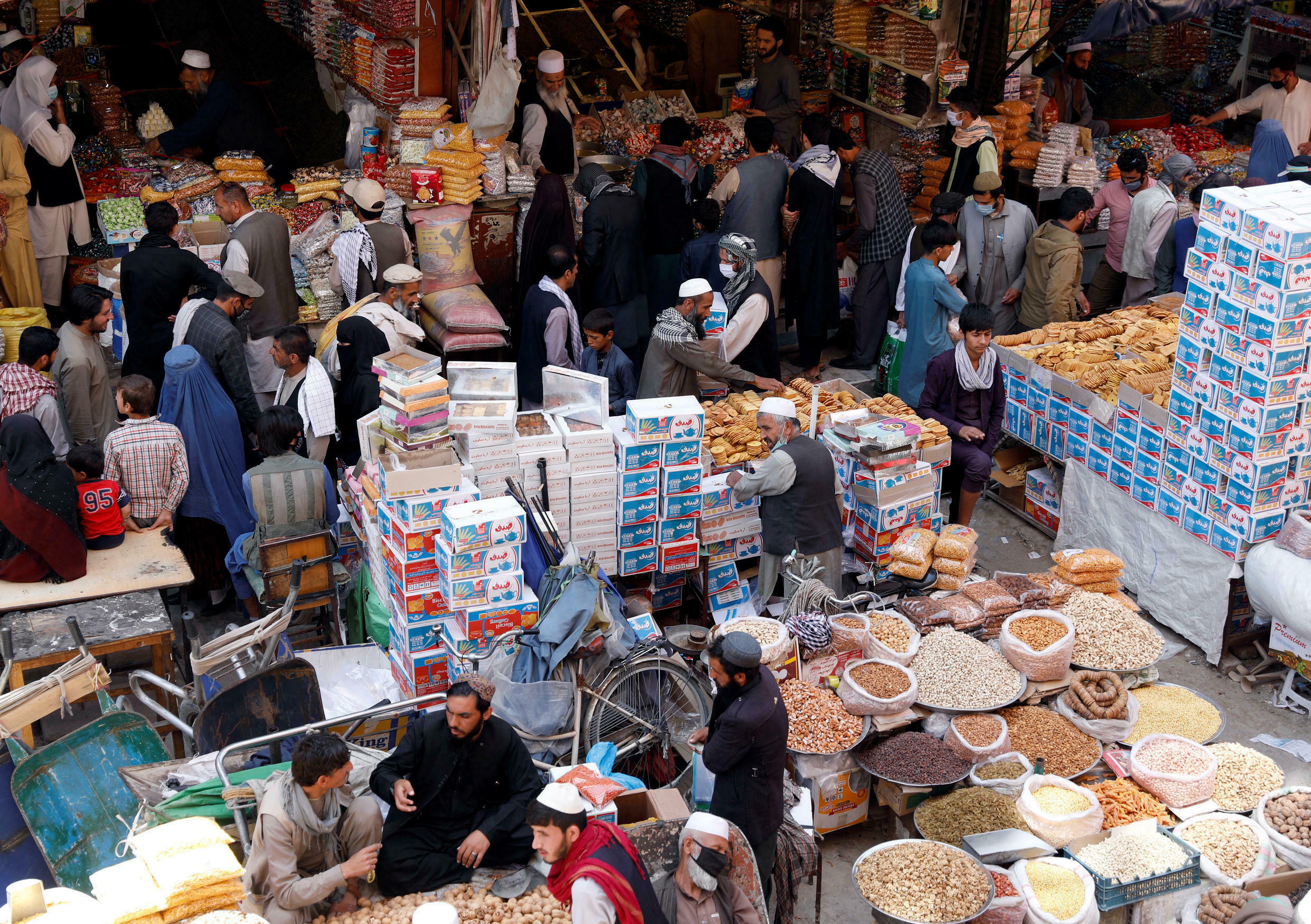 People shop for festive goods in preparation for Eid al-Fitr, marking the end of the fasting month of Ramadan amid the spread of the coronavirus disease (COVID-19), in Kabul, Afghanistan May 21, 2020.