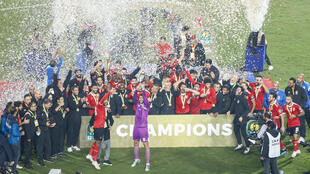 Al Ahly celebrate after defeating fellow Cairo club Zamalek Friday in the CAF Champions League final.