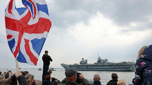 The Royal Navy's flagship, HMS Queen Elizabeth, leaves Portsmouth Naval Base on the south coast of England, on May 1