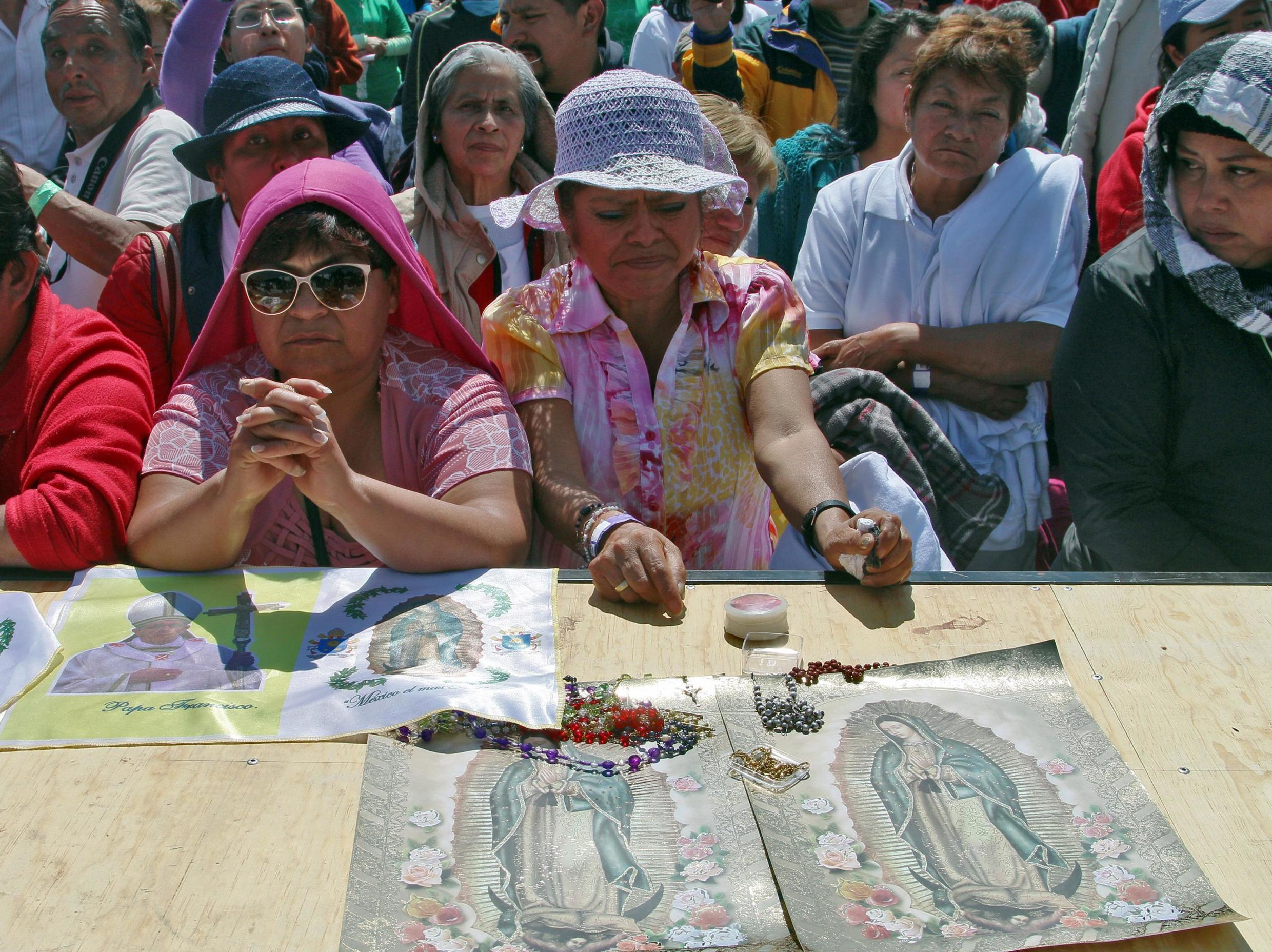 Catholic faithful participate in Pope Francis' open-air mass in Ecatepec, a rough, crime-plagued Mexico City suburb-- on February 14, 2016.