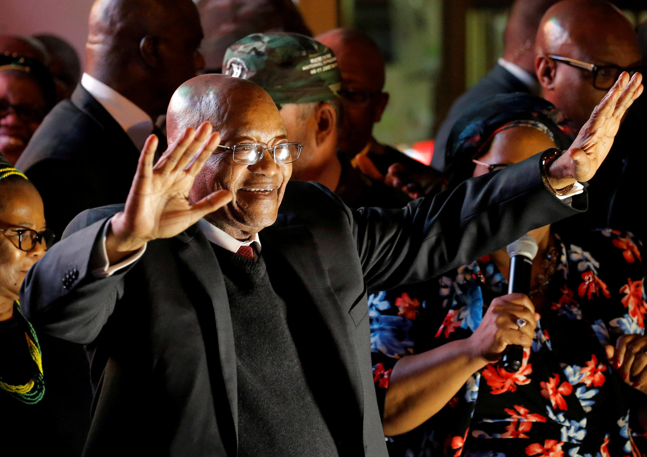 South Africa's President Jacob Zuma celebrates with his supporters after he survived a no-confidence motion in parliament in Cape Town on August 8, 2017