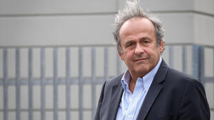 Platini arriving for Monday's hearing