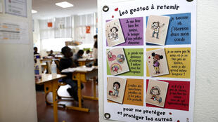 A sign explaining security measures to schoolchildren is displayed on a wall during the visit of French President Emmanuel Macron and French Education Minister Jean-Michel Blanquer at the Pierre de Ronsard elementary school in Poissy, France, May 5, 2020, as the country readies to face an ease in the coronavirus lockdown measures.