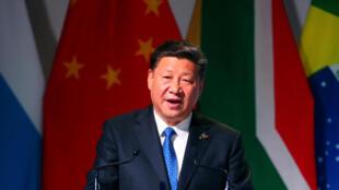 «L'unilatéralisme et le protectionnisme progressent et portent un coup sévère au multilatéralisme et au commerce multilatéral», a déclaré le président chinois Xi Jinping, au sommet des BRICS, à Johannesburg, le 25 juillet 2018.