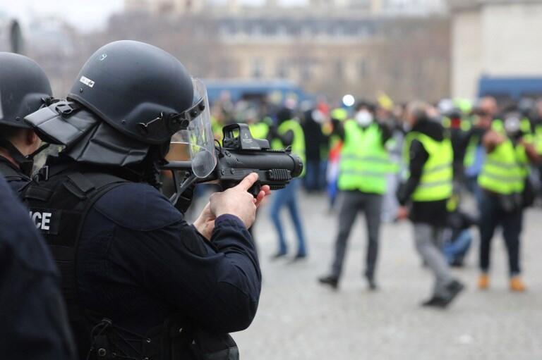 A French policeman armed with an LBD, a non-lethal crowd control munition, place de la Bastille, Paris, 12 January, 2019