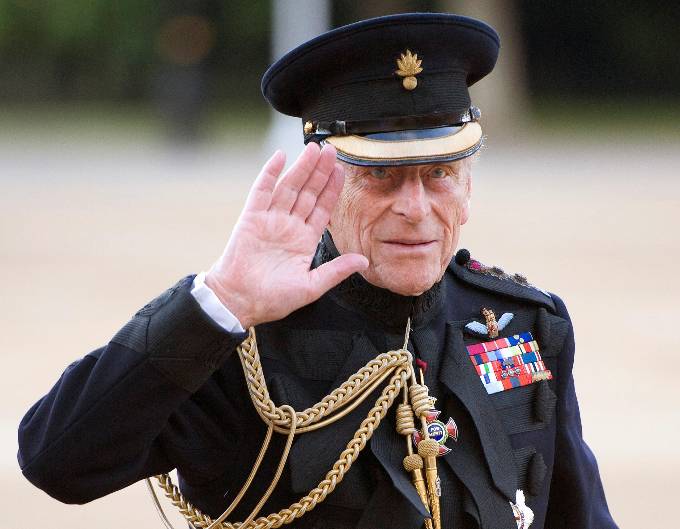 Britain's Prince Philip arrives on the eve of his 90th birthday to take the salute of the Household Division Beating Retreat on Horse Guards Parade in London June 9, 2011.