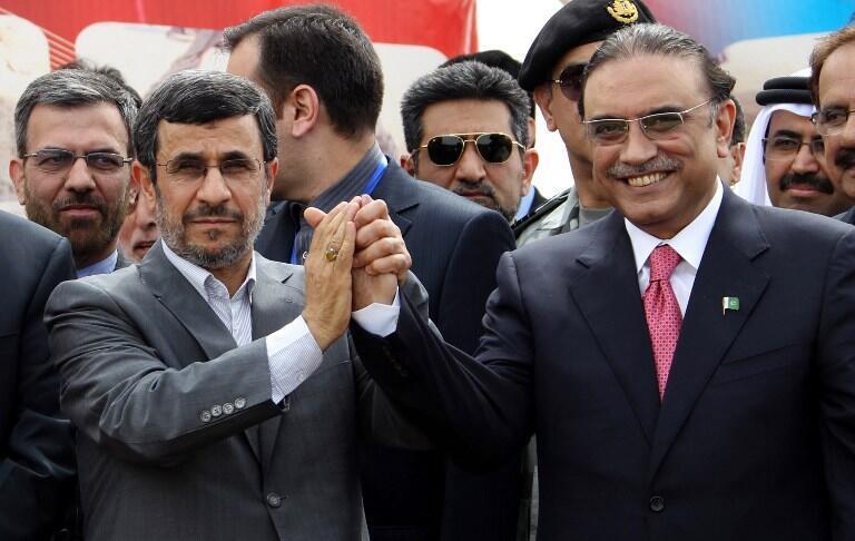 Iran's President Mahmoud Ahmadinejad (C) shakes hands with Pakistan's President Asif Ali Zardari during a ceremony marking the start of work on the 780-kilometre (485-mile) pipeline from Iran to Pakistan
