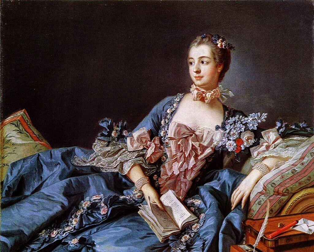 Jeanne-Antoinette Lenormant d'Etiolles, a legendária Marquesa de Pompadour, retratada com um livros nas mãos, referência à sua predileção pelas artes.