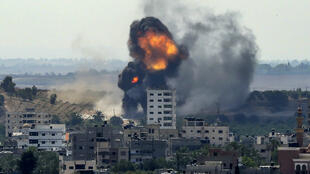 A ball of fire erupts from a building in Gaza City's Rimal residential district on May 20, 2021, during Israeli bombardment