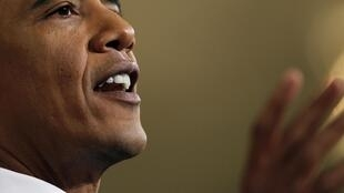 U.S. President Barack Obama makes a point during his news conference in the East Room of the White House in Washington