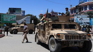Afghan security forces sit in a Humvee vehicle on May 19 amid fighting between Taliban militants and Afghan security forces in Kunduz