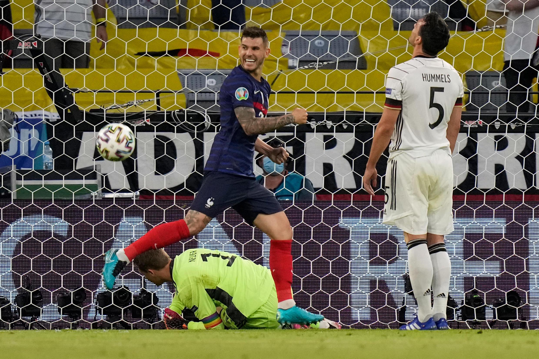 France's defender Lucas Hernandez (L) celebrates after an own goal by Germany defender Mats Hummels (R)