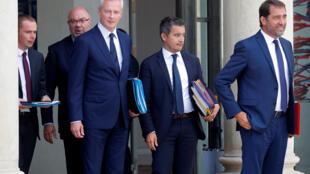 Французские министры выходят из Елисейского дворца после совещания, 22 августа 2018.