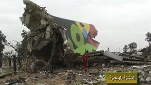 Rescue workers examine the debris of Afriqiyah airline flight 8U771 at Tripoli airport