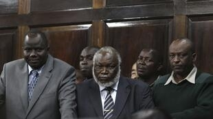 Kenyan Member of Parliament Kapondi and Assistant Minister for Roads Machage stand in the dock in Nairobi