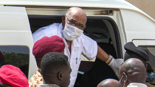 Sudan's ousted President Omar al-Bashir leaving a vehicle upon arriving at the courthouse to attend his trial, Khartoum, 21 July 2020.