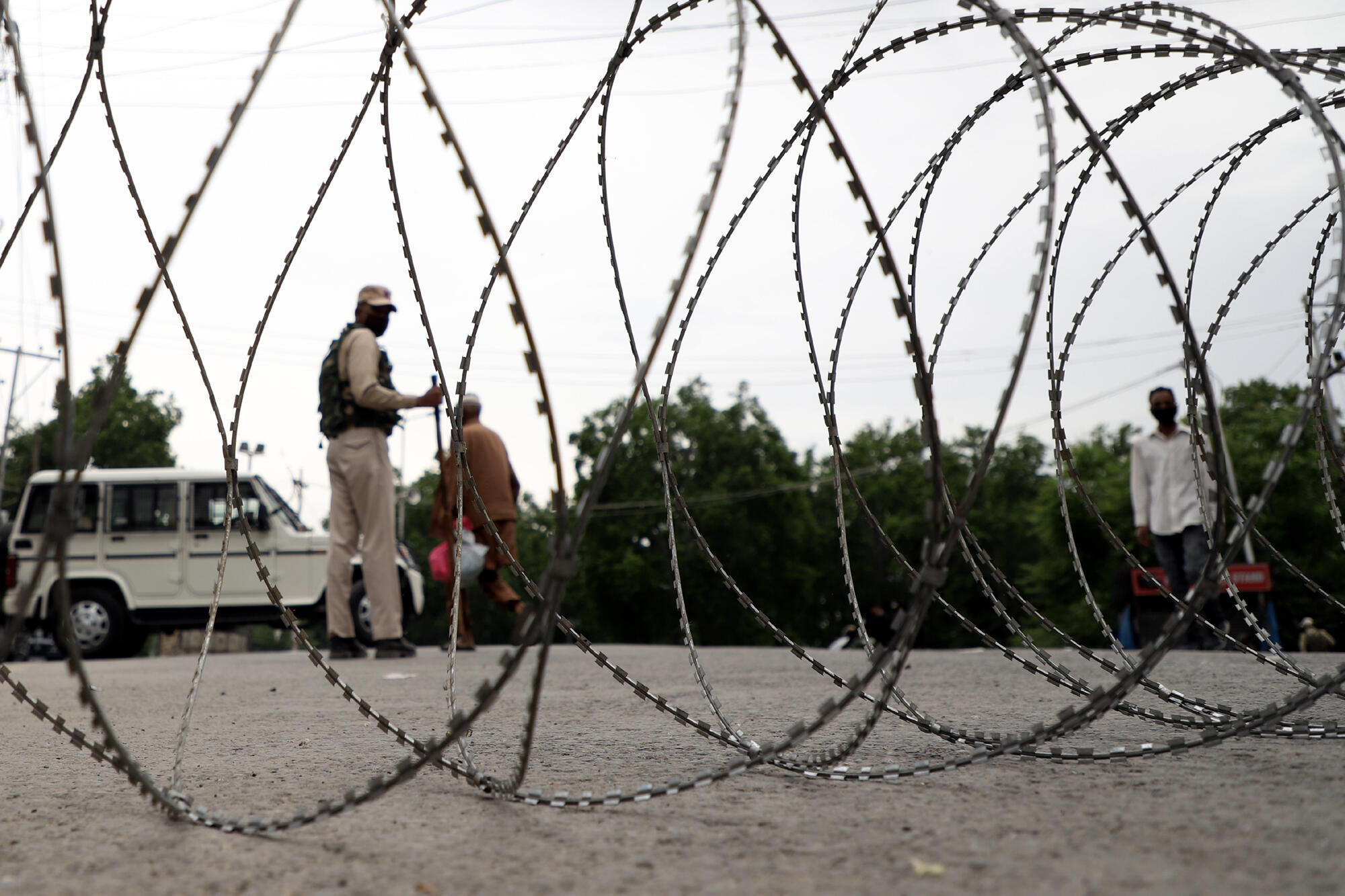 Barbed wire laid on the streets to stop vehicle movements in Indian-controlled Kashmir