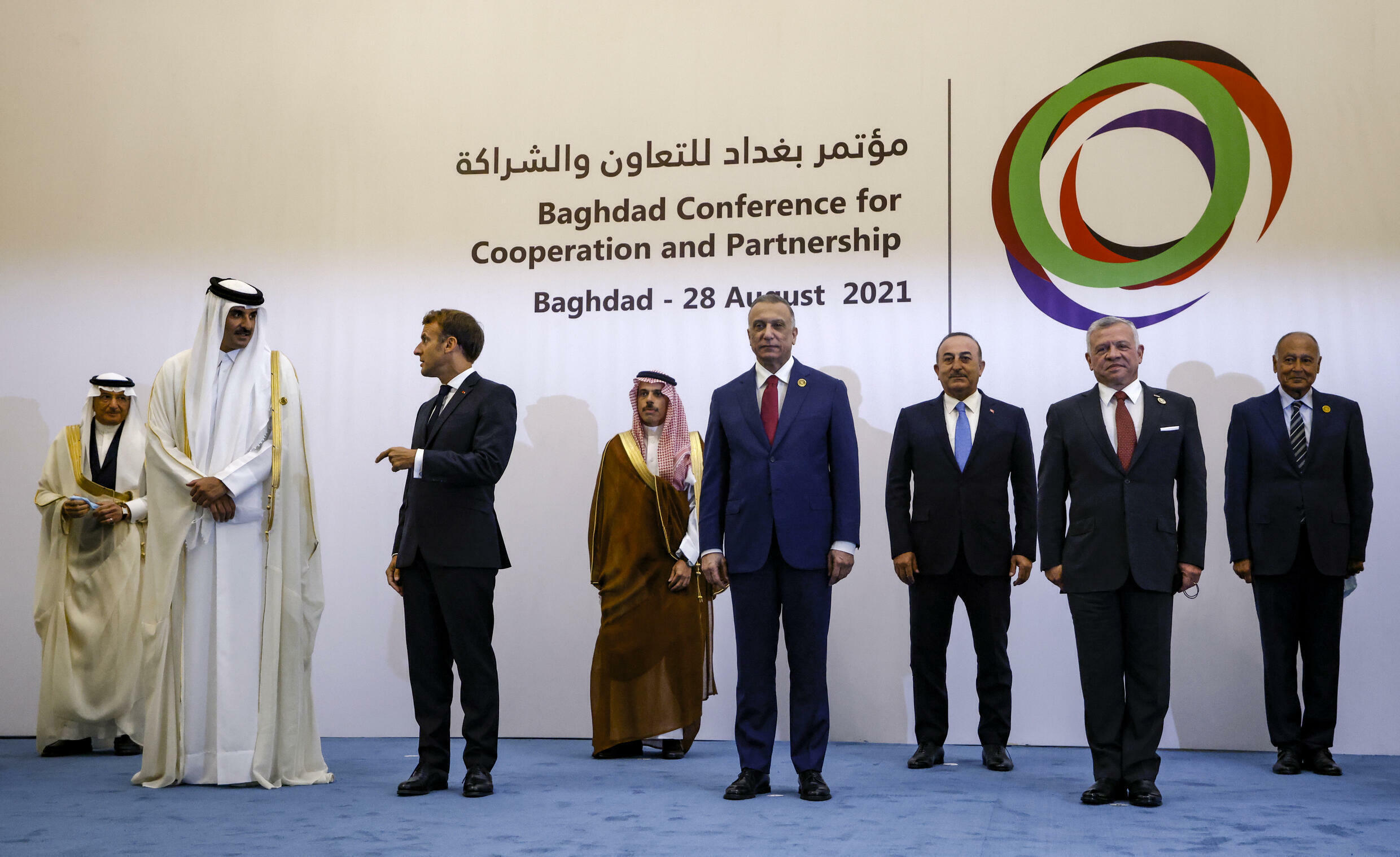 French President Emmanuel Macron (third from left) poses with other leaders at a regional meeting in Baghdad, August 28, 2021