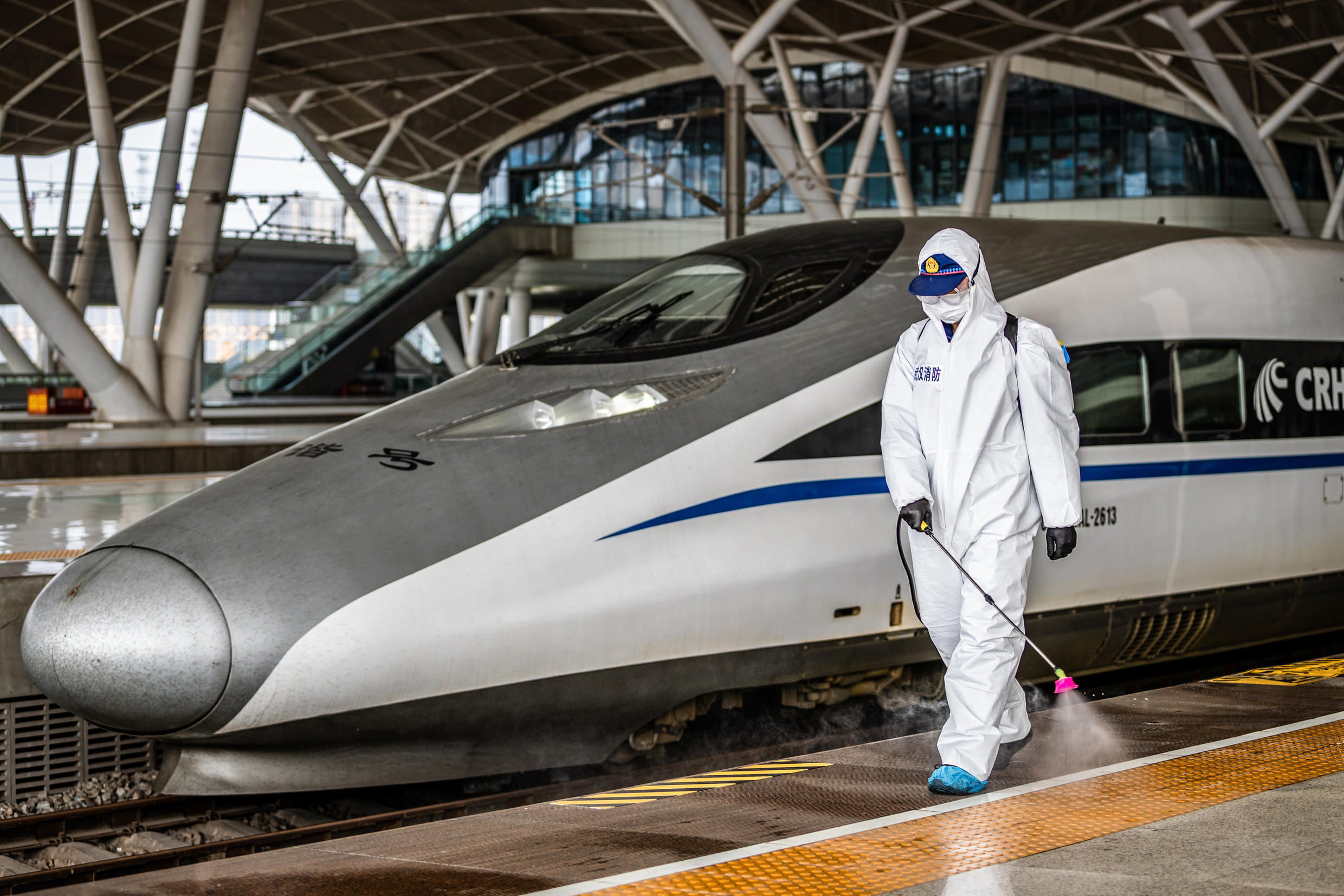 Health personnel spraying the platforms and trains in Wuhan, Hubei province, after local authorities lifted a transport ban. As of 24 March, outbound traffic is allowed from Hubei province, Wuhan will be open to traffic as of April 8