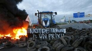 Farmers block access to the motorway A1 between Paris and Lille in northern France, 22 July
