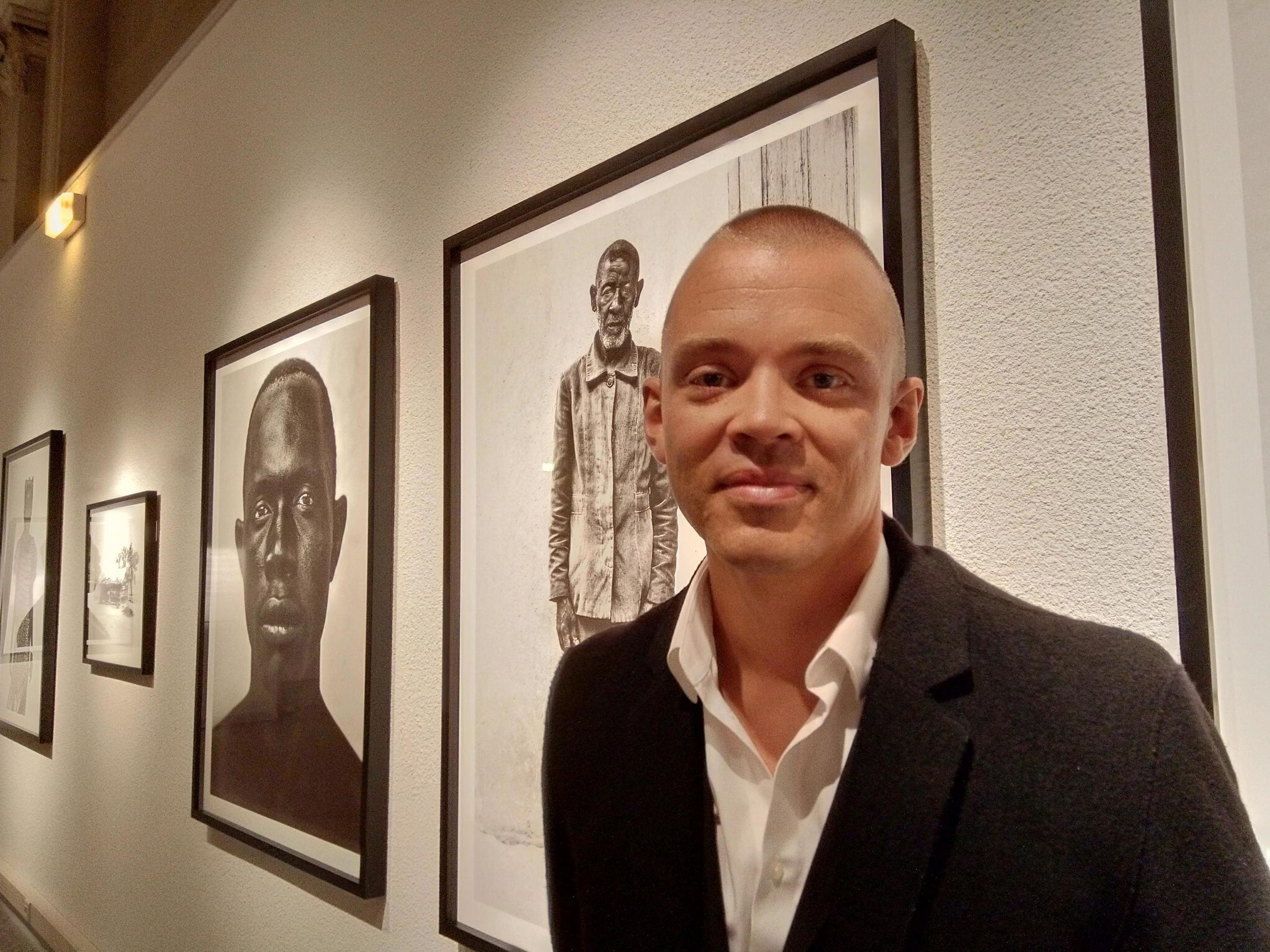 Bastiaan Woudt in front of his photographs at the annual Festival Portrait(s) in Vichy, France, June 2019
