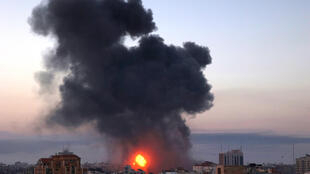 Smoke rises after an Israeli air strike in Gaza City early on May 12