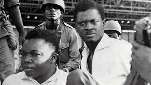 December 1960: Soldiers guard Congo's first post-independence prime minister, Patrice Lumumba, right, after his arrest. To the left is Joseph Okito, vice president of the Senate, who was shot dead alongside Lumumba the following month