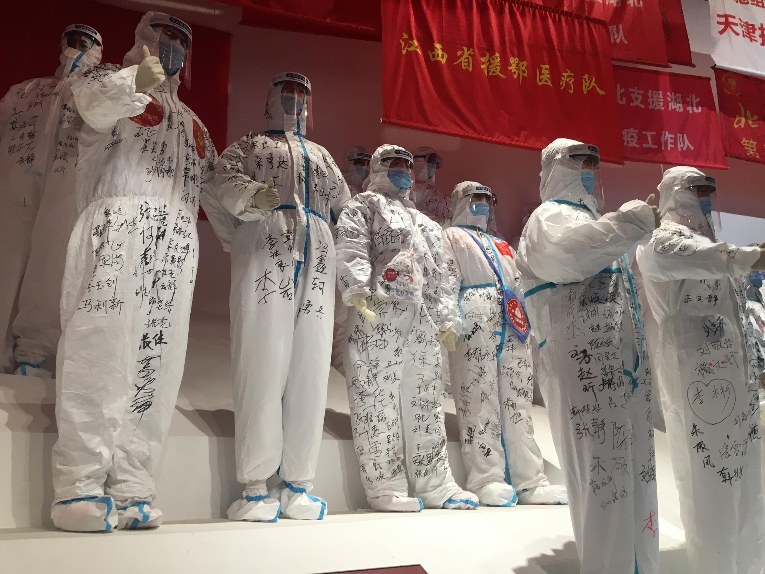 Covid-19 exhibition in Wuhan features life-size statues of health workers in full protective gear.