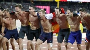 Kevin Mayer (centre) who claimed gold in the decathlon asked his fellow decathletes to strip off for the cameras as part of their lap of honour.