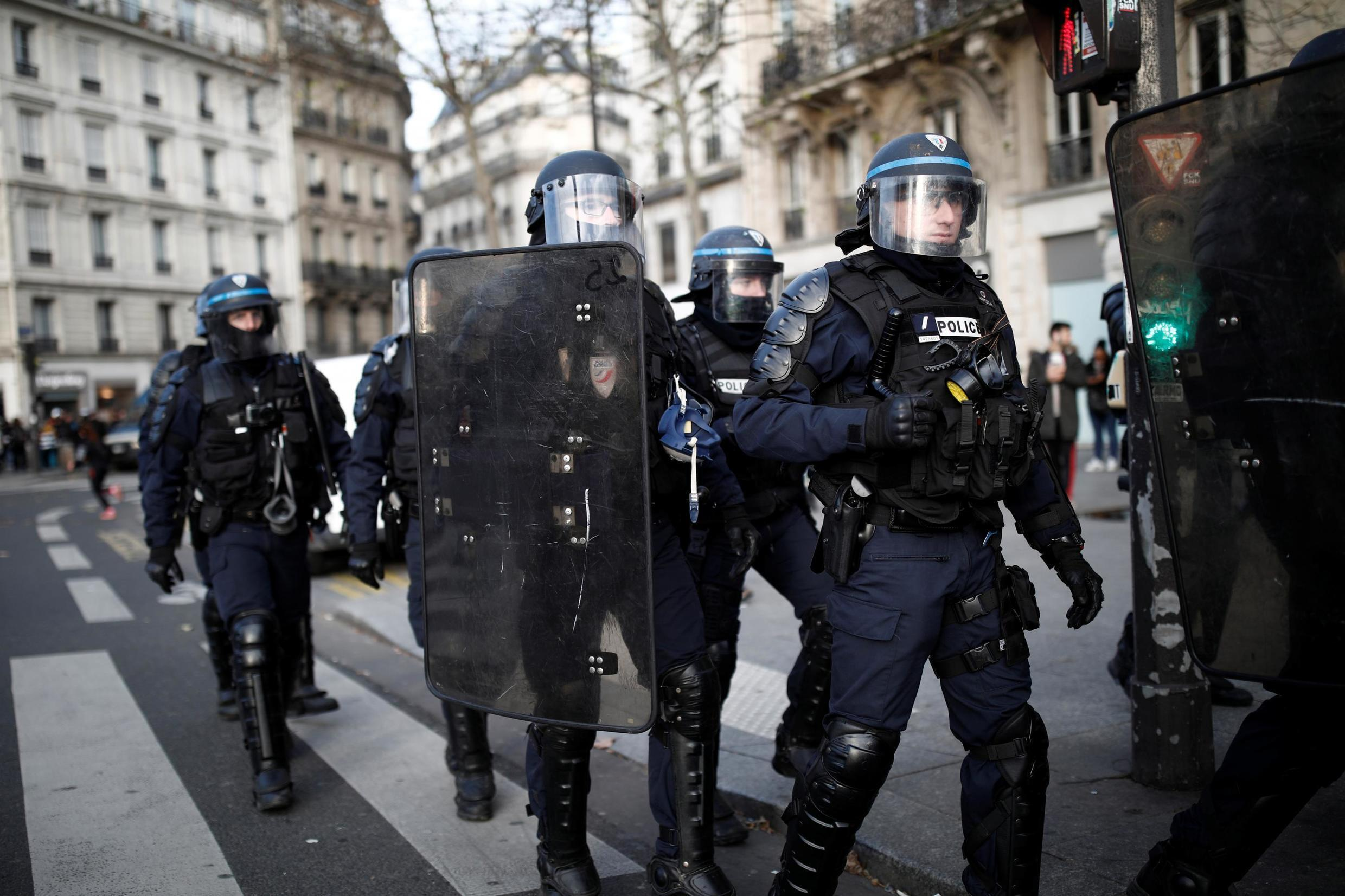 French riot police take position during a demonstration against French government's pensions reform plans in Paris as part of a second day of national strike and protests in France, December 10, 2019.
