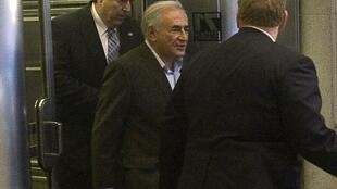 Dominique Strauss-Kahn leaves his temporary apartment