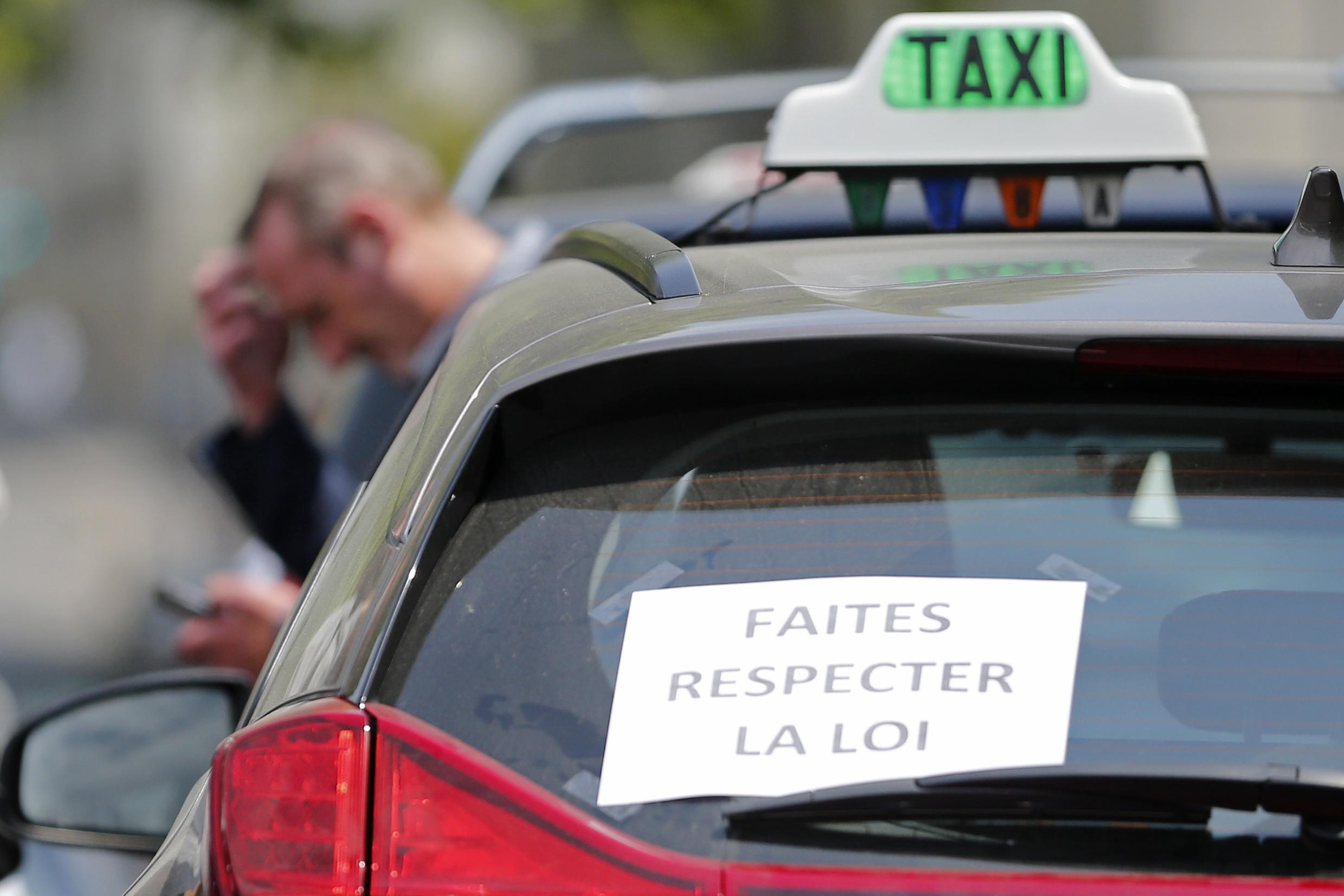 Taxi drivers demonstrate during a protest against car-sharing service Uber in Nantes, western France, June 9, 2015
