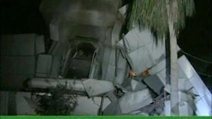 Part of damaged building in Libyan leader Muammar Gaddafi's Bab al-Aziziya compound in Tripoli
