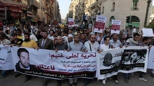 Anti-military protesters march towards the Peoples' Assembly during a rally in Cairo