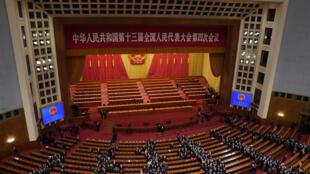 中国全国人大11日闭幕当日通过修改香港选举制度